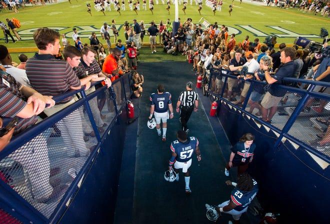 Auburn team captains take the field against Arkansas at Jordan-Hare Stadium in Auburn, Ala., on Saturday, Sept. 21, 2018. Auburn defeated Arkansas 34-3.