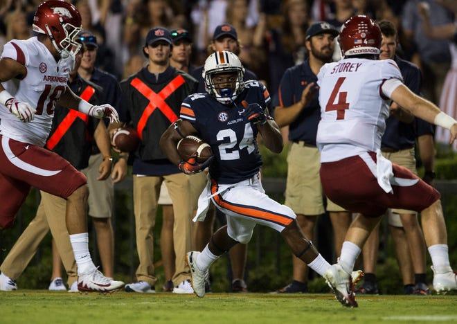 Auburn's Daniel Thomas (24) carries the ball on a fumble return against Arkansas at Jordan-Hare Stadium in Auburn, Ala., on Saturday, Sept. 21, 2018. Auburn leads Arkansas 17-0 at halftime.