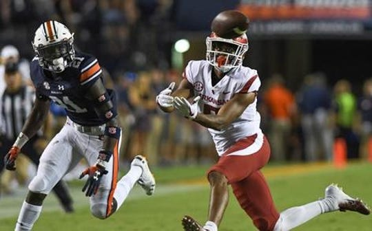 Arkansas wide receiver Jonathan Nance (7) eyes a pass defended by Auburn defensive back Smoke Monday (21) during the second quarter Saturday, Sept. 22, 2018, at Jordan-Hare Stadium in Auburn, Ala.
