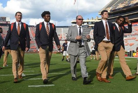 Auburn offensive coordinator Chip Lindsey walks the field with the quarterbacks from left, Cord Sandberg (24), Malik Willis (14), Jarrett Stidham (8) and Devin Adams (16) before the Arkansas game Saturday, Sept. 22, 2018, at Jordan-Hare Stadium in Auburn, Ala.