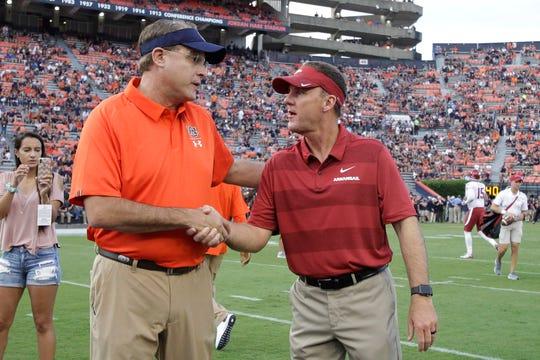 Auburn head coach Gus Malzahn talks with Arkansas head coach Chad Morris prior to the game at Jordan-Hare Stadium on Sept. 18, 2018.