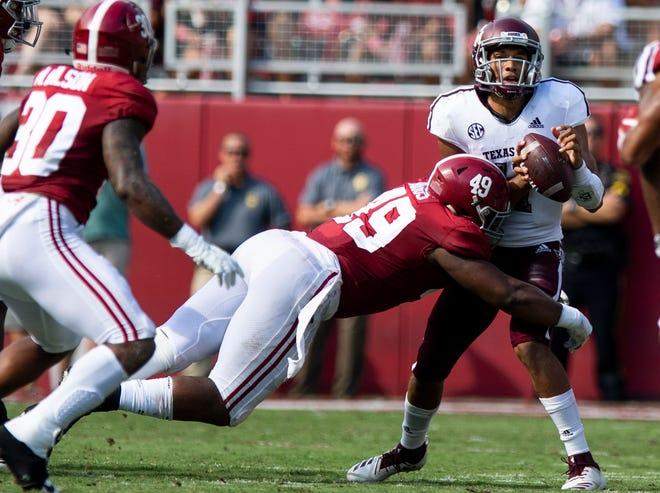 Alabama defensive lineman Isaiah Buggs (49) sacks Texas A&M quarterback Kellen Mond (11) In first half action in Tuscaloosa, Ala., on Saturday September 22, 2018.