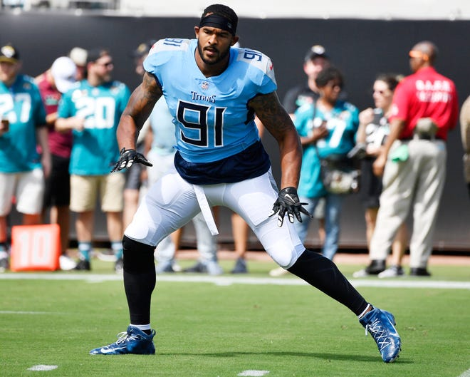 Titans linebacker Derrick Morgan (91) warms up before the game against the Jaguars on Sept. 23.