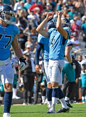 Titans placekicker Ryan Succop (4) celebrates his field goal to make the score 9-6 in the fourth quarter Sunday.