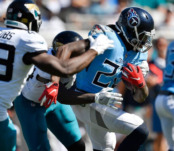 Titans running back Derrick Henry (22) powers up the field in the fourth quarter Sunday.