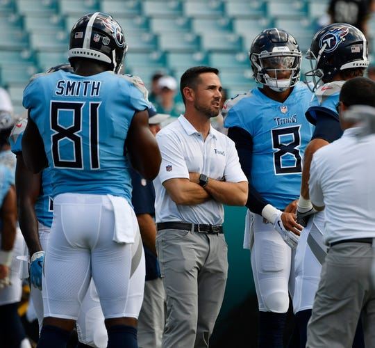Titans offensive coordinator Matt Lafleur talks to quarterback Blaine Gabbert (7) before the game at TIAA Bank Field Sunday, Sept. 23, 2018, in Nashville, Tenn.