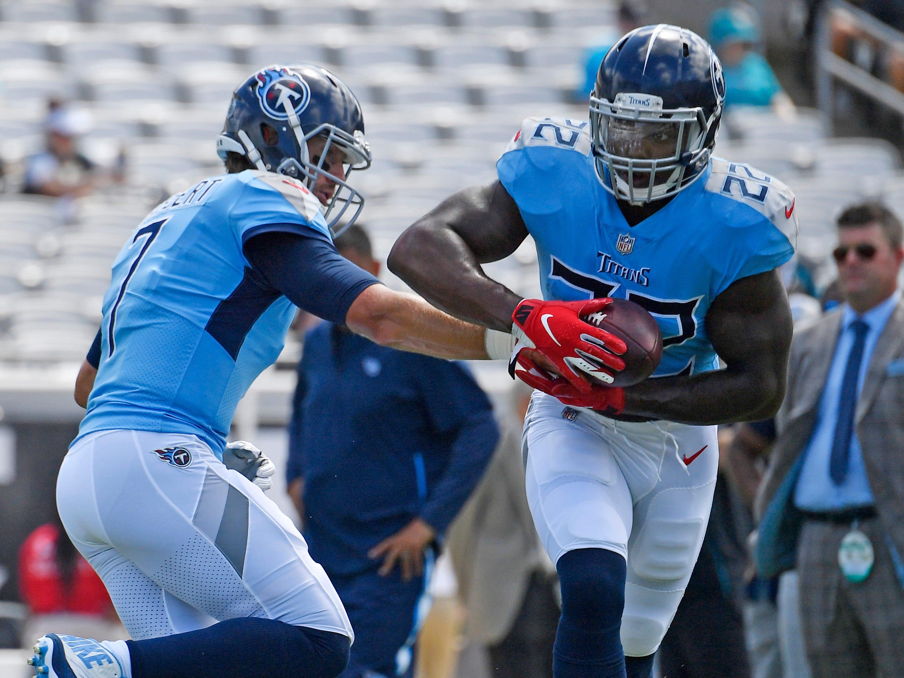 Titans running back Derrick Henry (22) takes a handoff from quarterback Blaine Gabbert (7) in warmups at TIAA Bank Field Sunday, Sept. 23, 2018, in Nashville, Tenn.