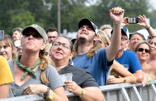 Amos Lee fans listen to him perform at Pilgrimage Festival at The Park at Harlinsdale Farm Saturday, Sept. 22, 2018, in Franklin, Tenn.