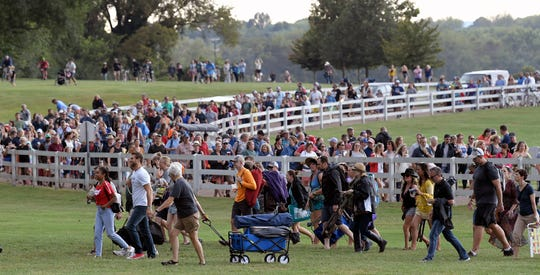 Music fans leave the grounds at Pilgrimage Music & Cultural Festival after a temporarily postponing event due to severe weather on Saturday, Sept. 22, 2018.
