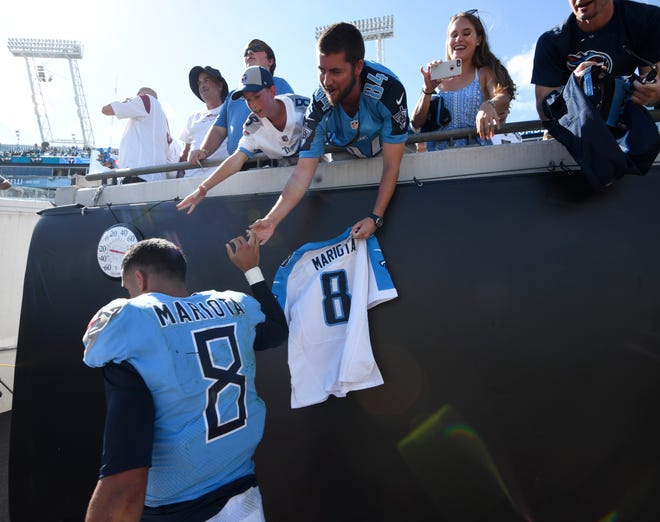 Titans quarterback Marcus Mariota (8) slaps hands with fans after the team's 9-6 win over the Jaguars at TIAA Bank Field Sunday, Sept. 23, 2018, in Nashville, Tenn.