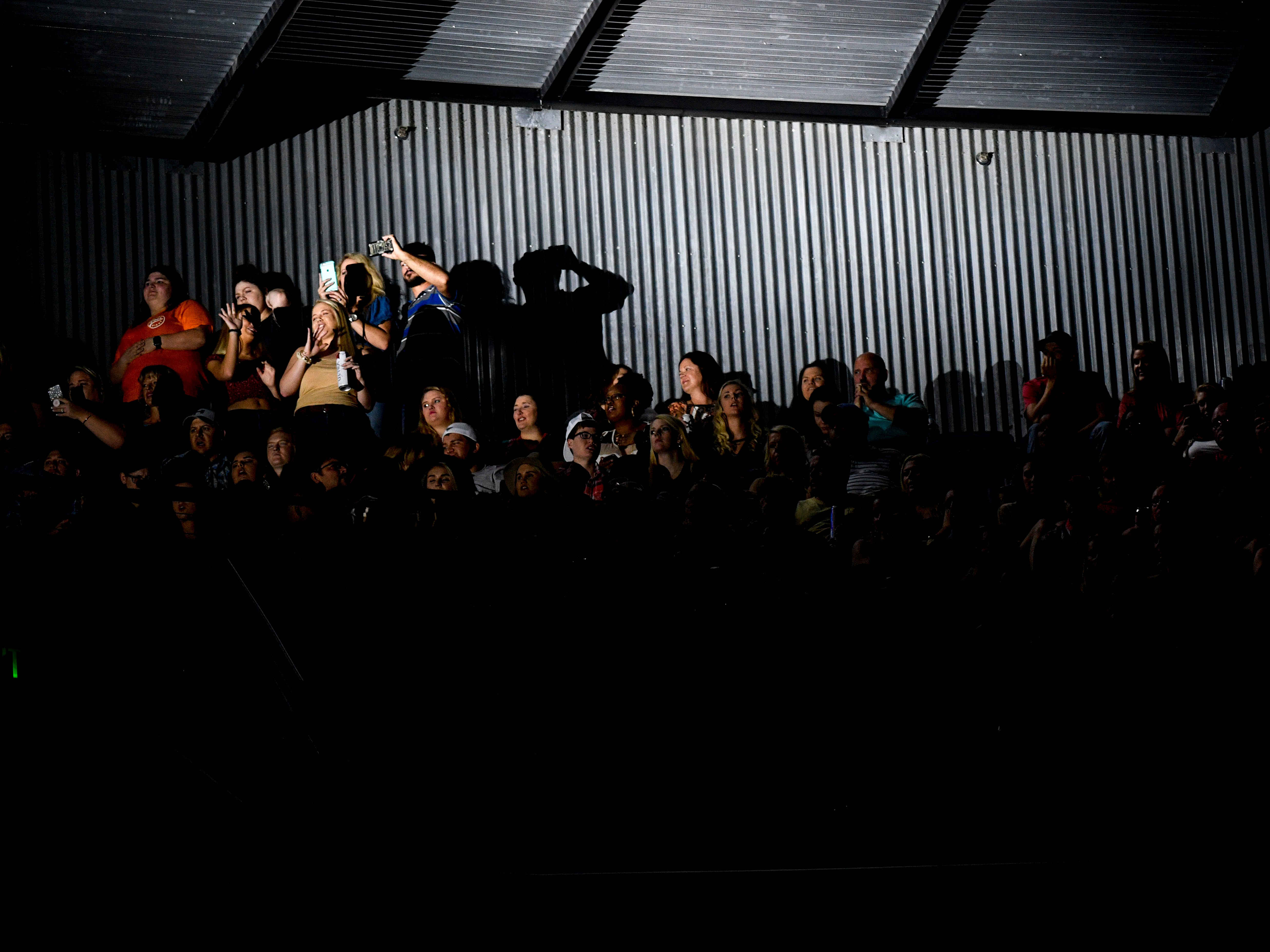 Fans perched high in the stadium seating dance and watch as Kane Brown performs as an opening act for Chris Young at Bridgestone Arena in Nashville, Tenn., Saturday, Sept. 22, 2018.