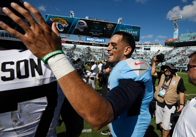 Titans quarterback Marcus Mariota (8) celebrates on the field after the team's 9-6 win over the Jaguars on Sunday at TIAA Bank Field in Jacksonville.