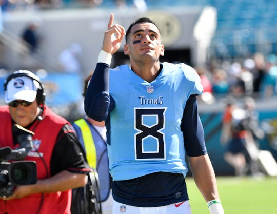 Titans quarterback Marcus Mariota (8) celebrates the team's win over the Jaguars.