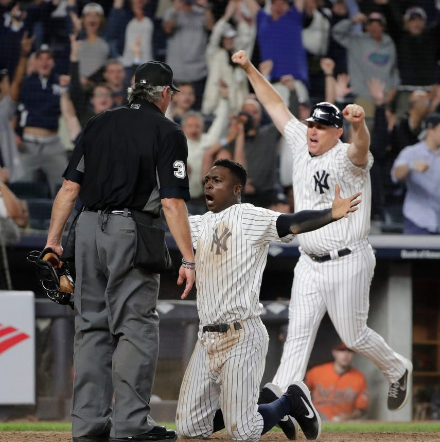Yankees clinch wild card spot with late victory over Baltimore