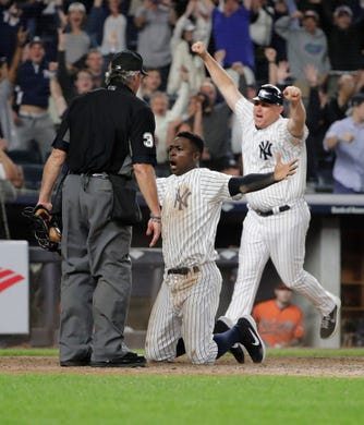 New York Yankees' Didi Gregorius celebrates after scoring during the eleventh inning of a baseball game against the Baltimore Orioles Saturday, Sept. 22, 2018, in New York.