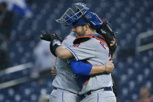 Sep 23, 2018; Washington, DC, USA; New York Mets relief pitcher Anthony Swarzak (38) celebrates with Mets catcher Kevin Plawecki (26) after defeating the Washington Nationals at Nationals Park.