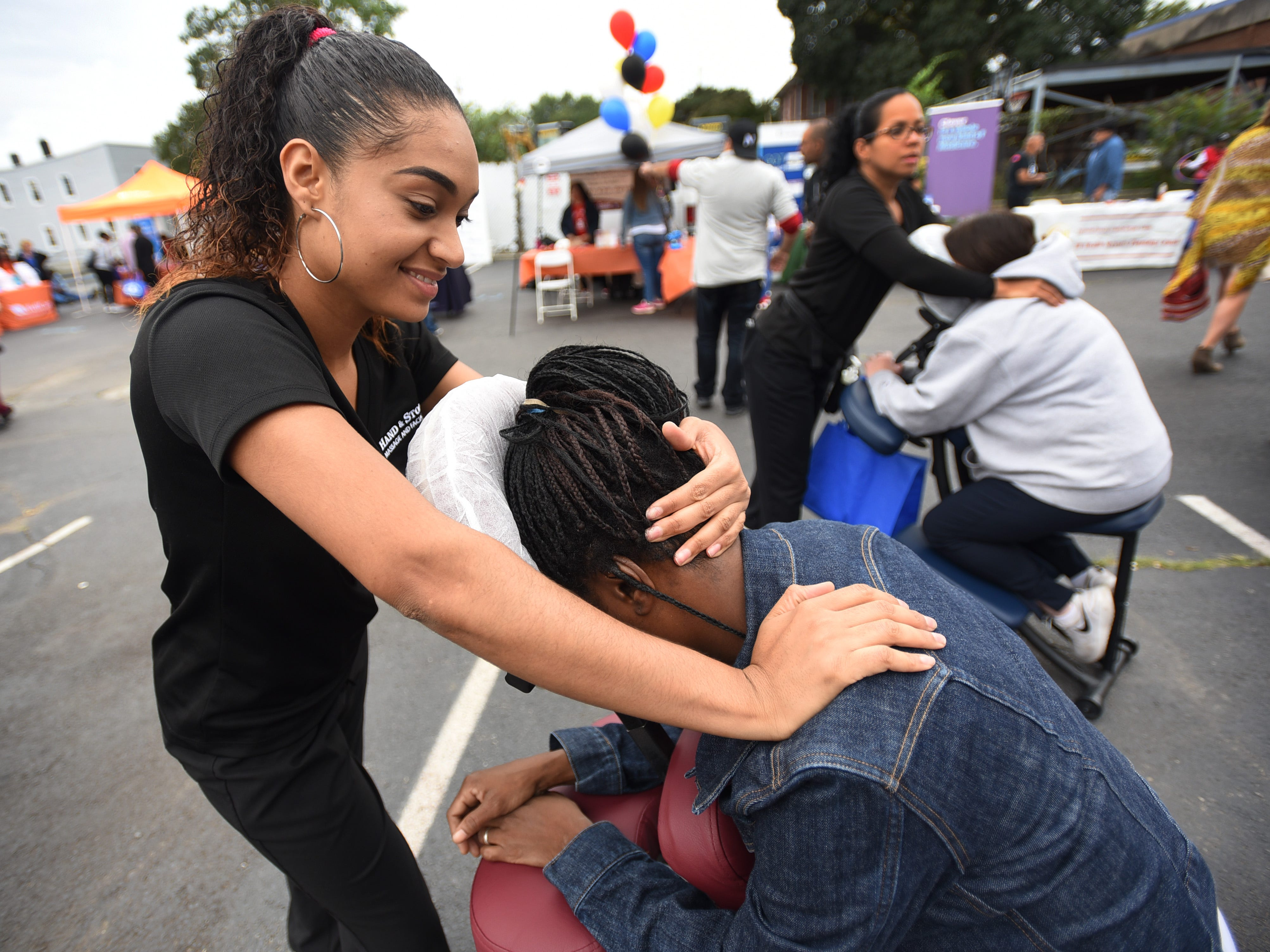 Welin Osorico of Hand & Stone, gives a massage to Felicia Smith of Hackensack during the first annual Resource and Community Wellness Fair held by Buddies of NJ in Hackensack on 0923/18. The Buddies support people living with or affected by HIV/AIDS