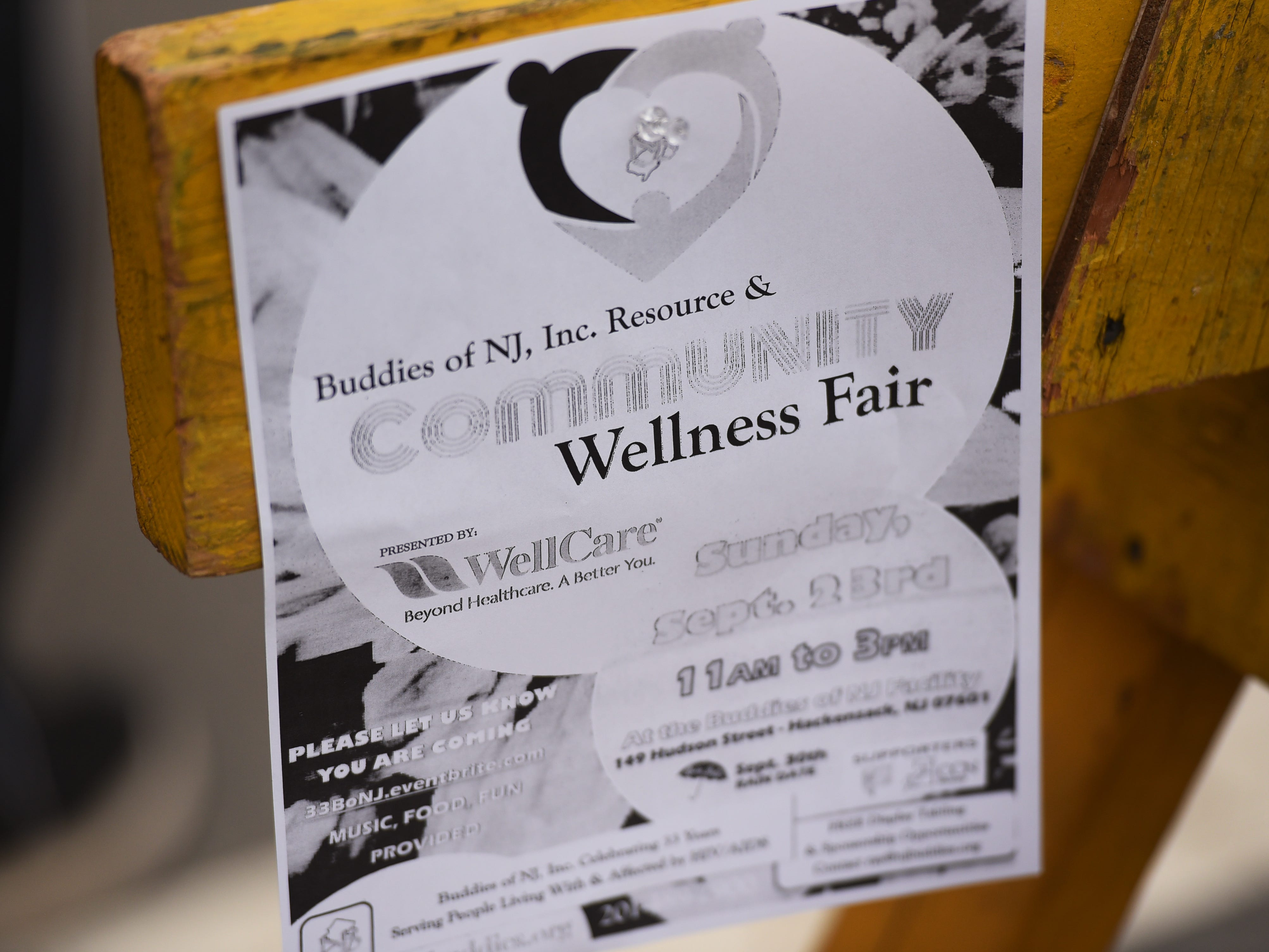 A flyer of the event is seen during the first annual Resource and Community Wellness Fair held by Buddies of NJ in Hackensack on 0923/18. The Buddies support people living with or affected by HIV/AIDS