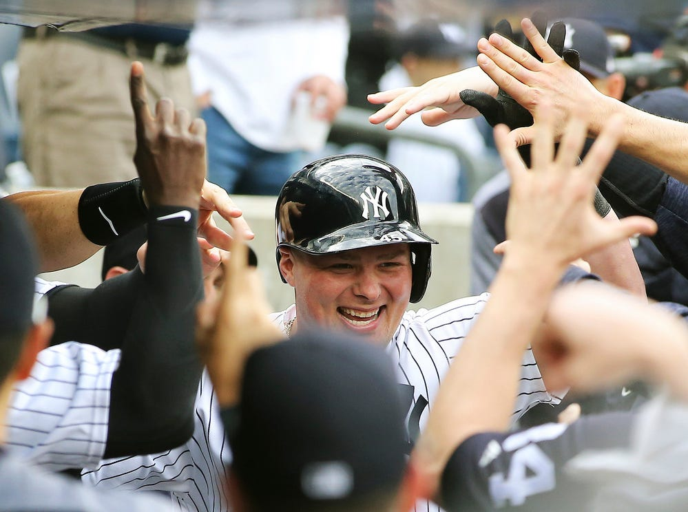 New York Yankees first baseman Luke Voit (45) is congratulated after hitting a solo home run against the Baltimore Orioles during the second inning at Yankee Stadium.