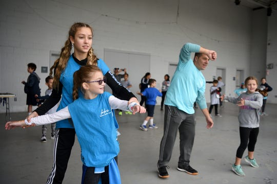 The 31st Annual CancerCare New Jersey Walk/Run for Hope was held at Overpeck County Park on Sunday, September 23, 2018. Joely Levin 9 and her sister Leah Monroe 15 of Monroe help warm-up participants in the walk/run on Sunday morning.