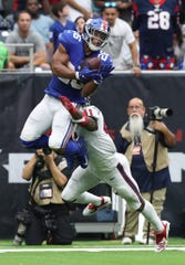Sep 23, 2018; Houston, TX, USA; New York Giants running back Saquon Barkley (26) makes a catch on third down in the fourth quarter against Houston Texans linebacker Zach Cunningham (41) at NRG Stadium.