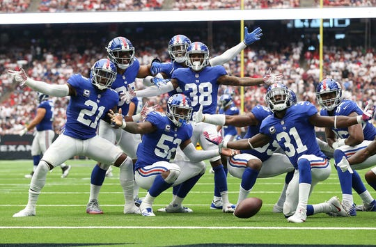 Sep 23, 2018; Houston, TX, USA; New York Giants defense strike a pose after recovering a fumble in the third quarter against the Houston Texans at NRG Stadium.