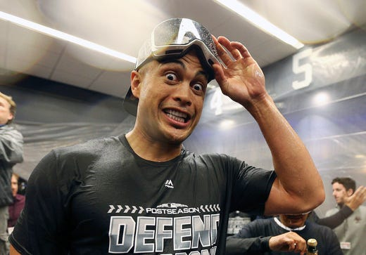 New York Yankees designated hitter Giancarlo Stanton (27) reacts in the locker room after defeating the Baltimore Orioles at Yankee Stadium. Mandatory Credit: Andy Marlin-USA TODAY Sports