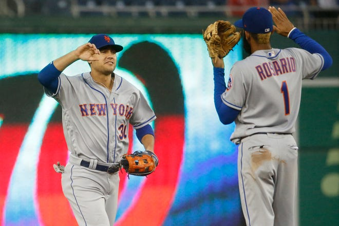 Sep 23, 2018; Washington, DC, USA; New York Mets left fielder Michael Conforto (30) celebrates with Mets shortstop Amed Rosario (1) after defeating the Washington Nationals at Nationals Park.
