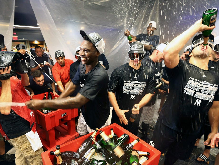 The New York Yankees celebrate in the locker room after defeating the Baltimore Orioles at Yankee Stadium. Mandatory Credit: Andy Marlin-USA TODAY Sports