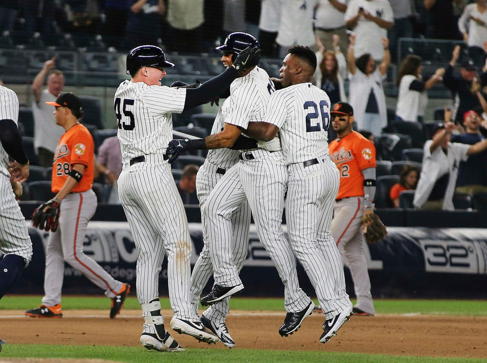 The New York Yankees celebrate after defeating the Baltimore Orioles at Yankee Stadium.