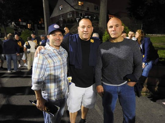 Former BHS players (from left) Michael Senesky, John Olivieri and Michael Gibbons at last Friday's game. The trio returned as part of the celebration of the 40th anniversary of Buccaneers football. Senesky is the youngest son of former BHS coach John Senesky.