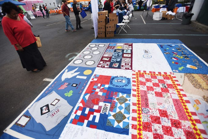 Deborah Mosley from NJ Buddies, looks at various quilts that shows people who died from HIV/AIDS, during the first annual Resource and Community Wellness Fair held by Buddies of NJ in Hackensack on 0923/18. The Buddies support people living with or affected by HIV/AIDS
