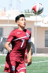 Senior Wildcat captain Adrian Chavez maintained focus on the soccer ball during Saturday's District 3-5A match against Gadsden High. Chavez collected an assist and was active from the midfield position
