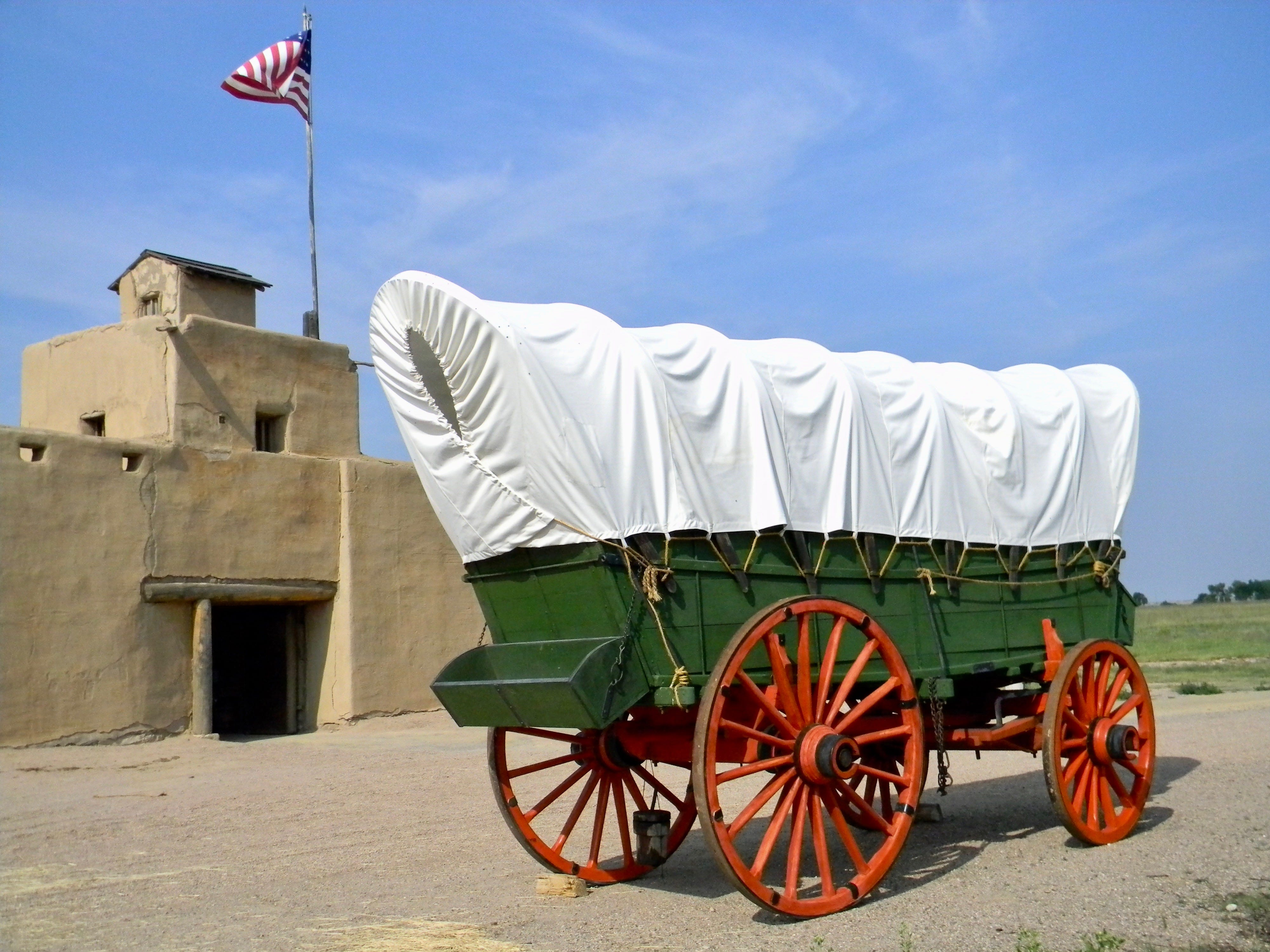 This conestoga wagon at Bent's Old Fort, popularly called a prairie schooner, was a mainstay in trade along the Santa Fe Trail. It was later replaced by larger Dearborn wagons.