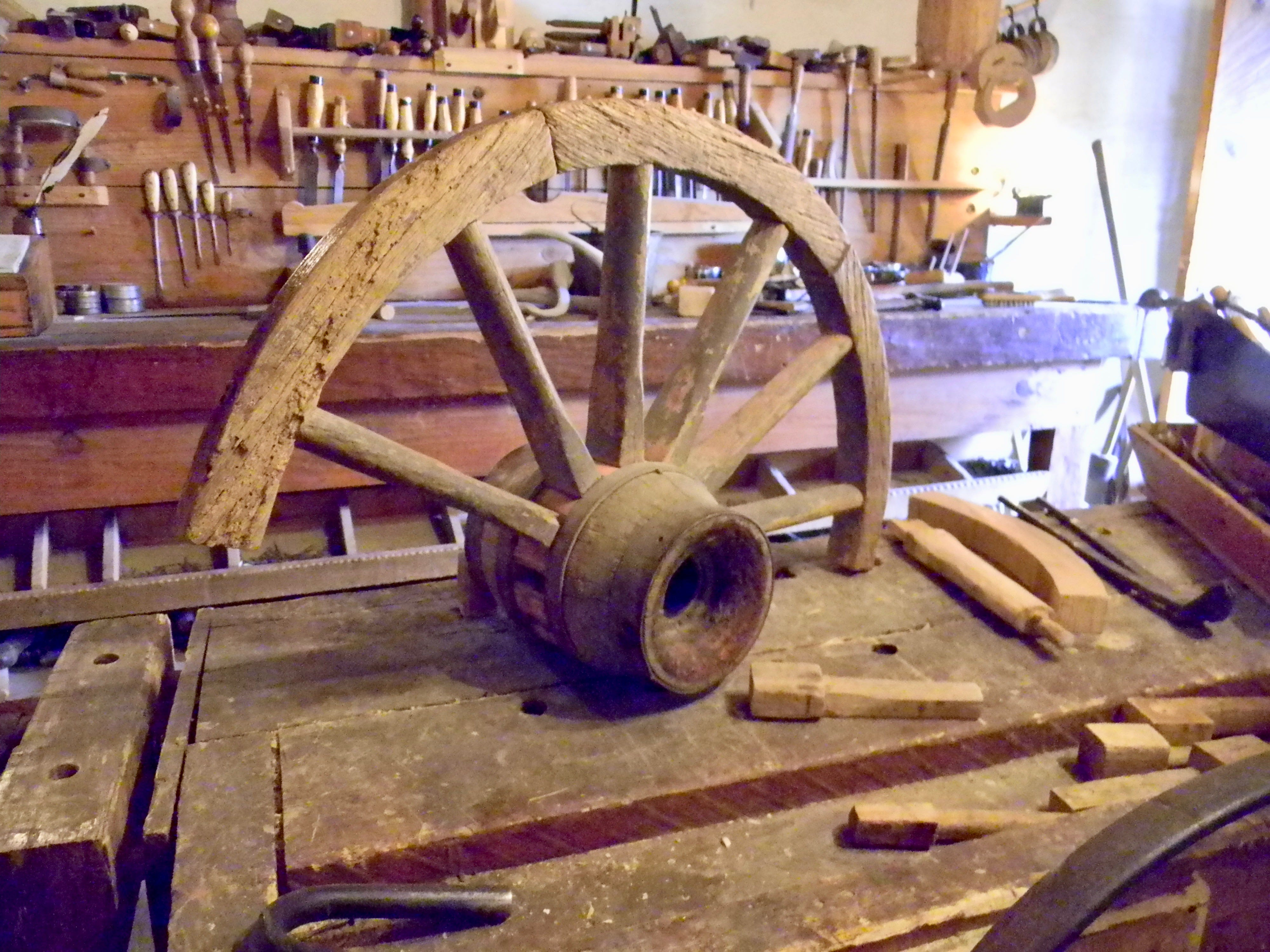 The Santa Fe Trail was hard on wheels, often rebuilt in the shop at Bent's Old Fort.