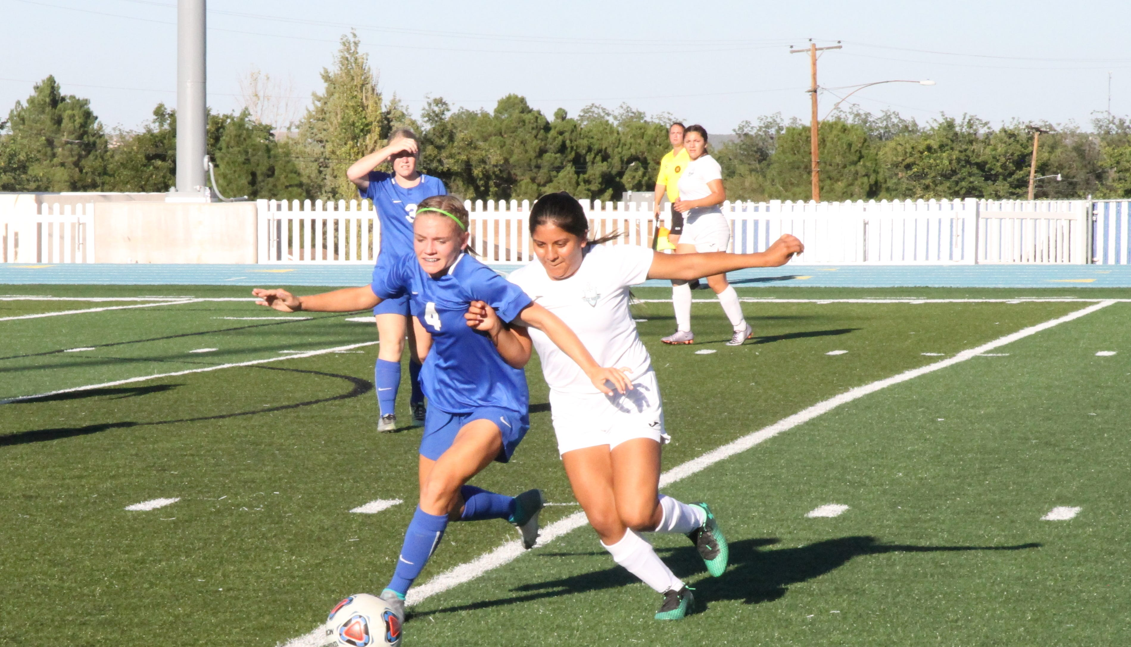 Alexa Dugan fights for possession during Saturday's game against Santa Teresa at Caveman Stadium. Dugan finished the game with one goal and one assist.