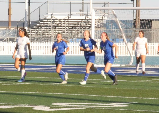 The trio of Saydie Bickerstaff (7), Emily Hervol (16) and Emma Haston (13) celebrate a goal in the second half of Saturday's game. Hervol scored two goals and Carlsbad beat Santa Teresa, 10-0.