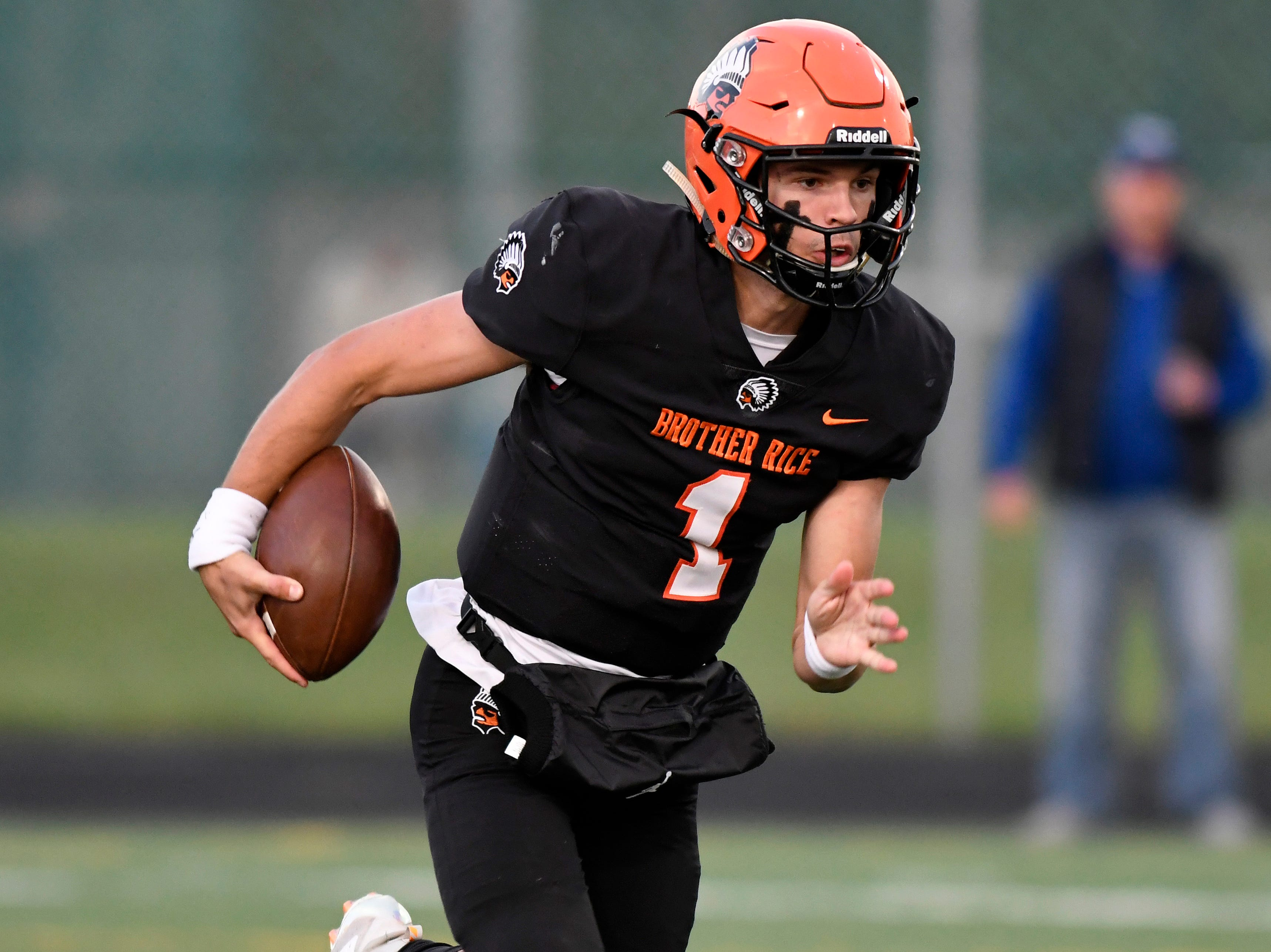IBirmingham Brother Rice quarterback Greg Piscopink (1) scrambles for yardage against Detroit Catholic Central n the first quarter, Saturday, Sept. 22, 2018 at Hurley Field in Berkley, Mich.  Catholic Central defeated Brother Rice, 21-0.  (Jose Juarez/Hometown Life)