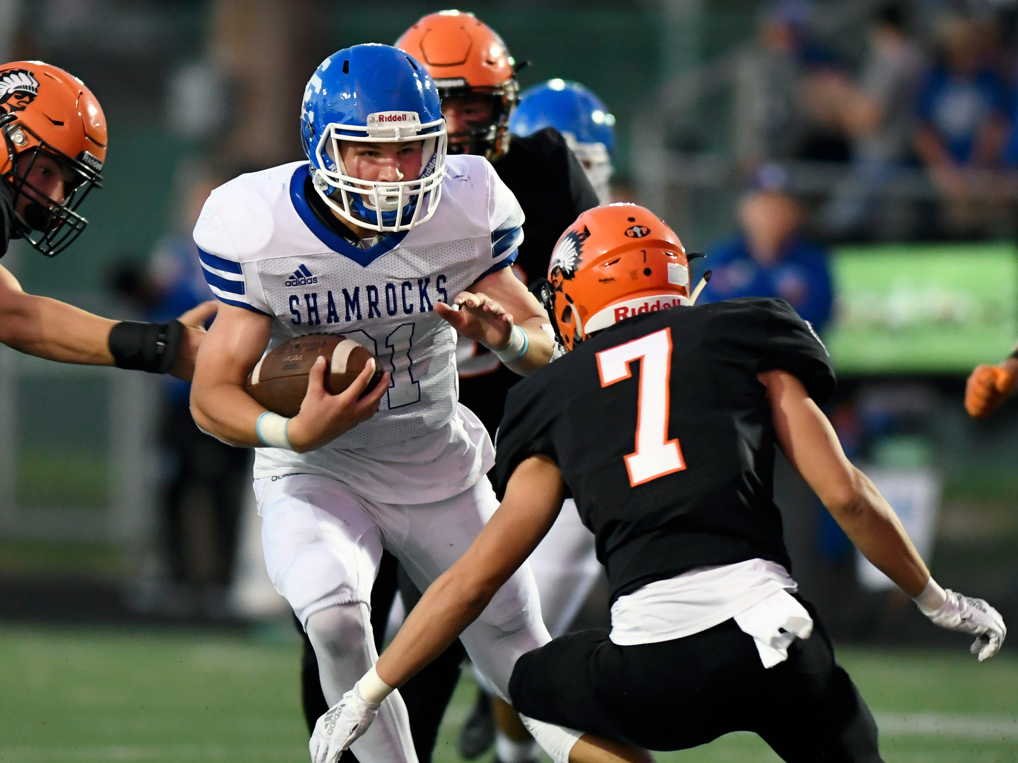 Detroit Catholic Central running back Keegan Koehler (21) rushes for yardage against Birmingham Brother Rice in the second quarter, Saturday, Sept. 22, 2018 at Hurley Field in Berkley, Mich.  Catholic Central defeated Brother Rice, 21-0.  (Jose Juarez/Hometown Life)