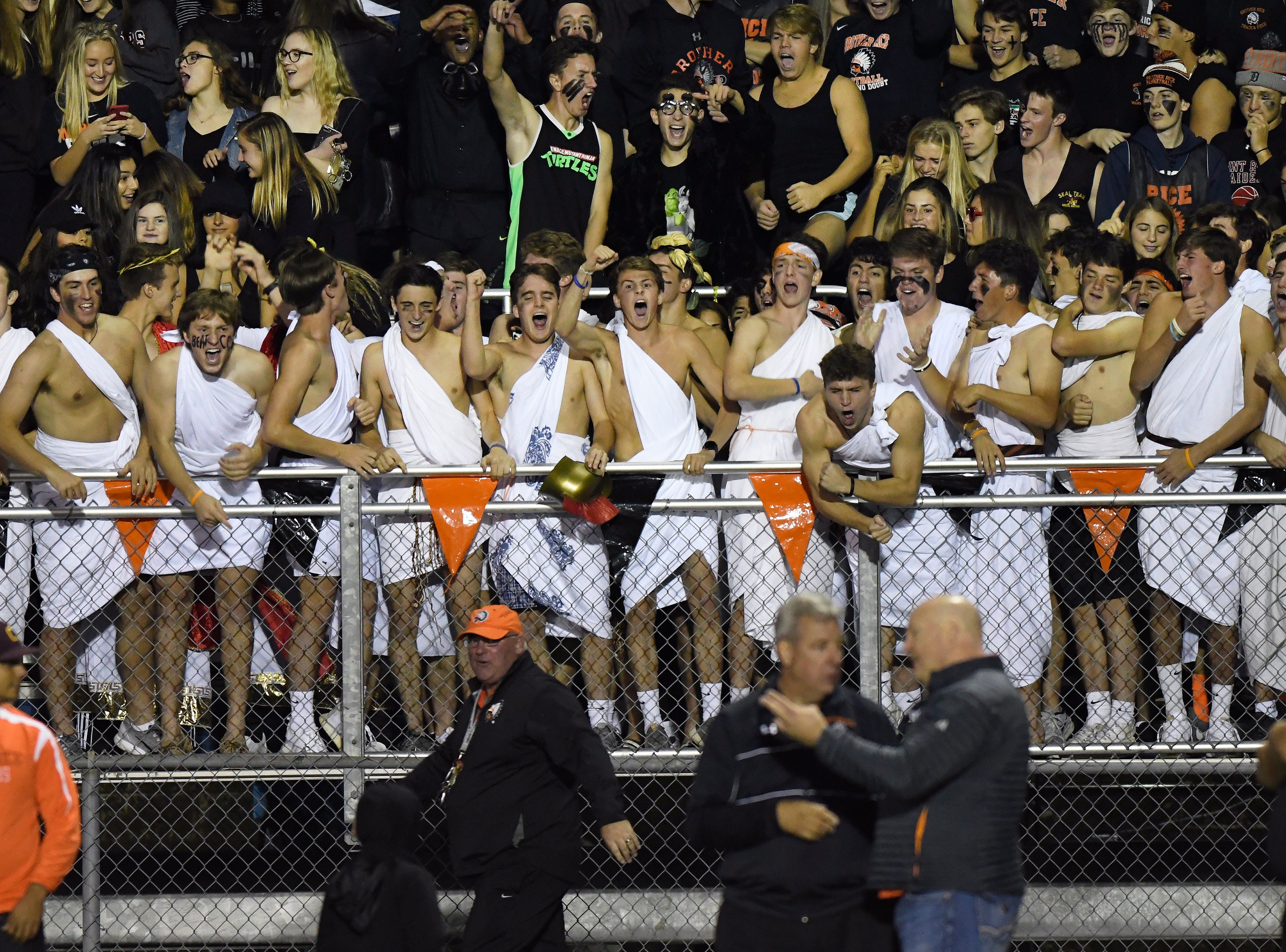 Birmingham Brother Rice students, many in togas, have fun as they cheer on their team as the played against Detroit Catholic Central in the fourth quarter, Saturday, Sept. 22, 2018 at Hurley Field in Berkley, Mich.  Catholic Central defeated Brother Rice, 21-0.