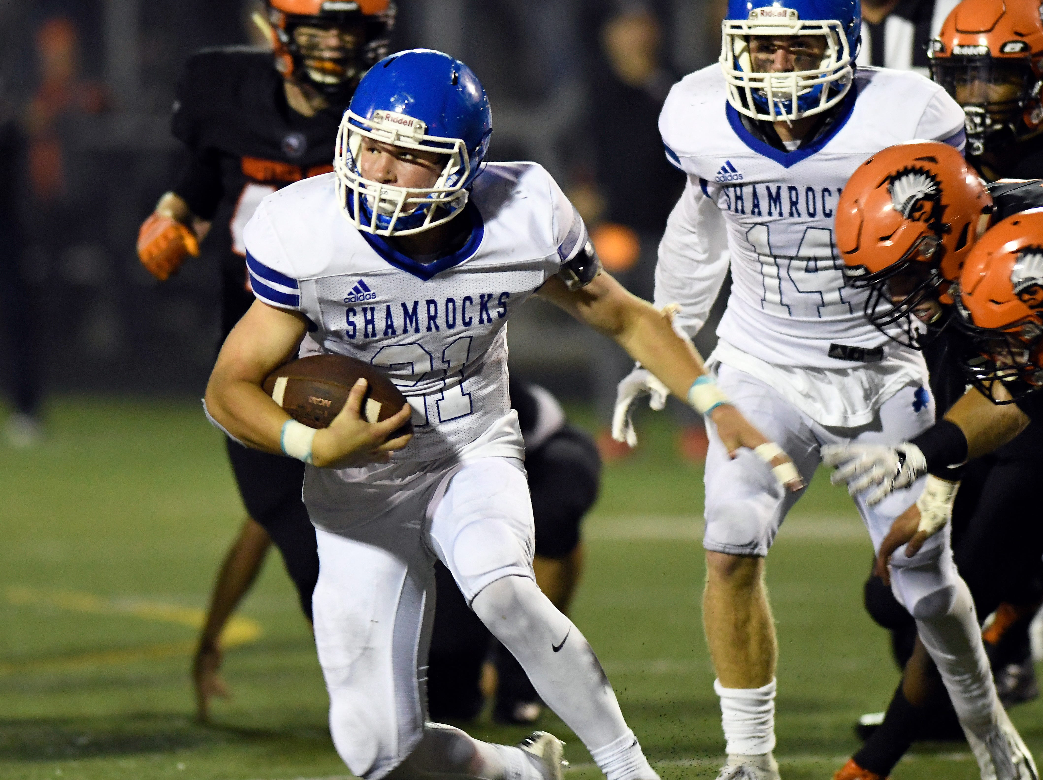 Detroit Catholic Central running back Keegan Koehler (21) rushes for yardage against Birmingham Brother Rice in the fourth quarter, Saturday, Sept. 22, 2018 at Hurley Field in Berkley, Mich.  Catholic Central defeated Brother Rice, 21-0.