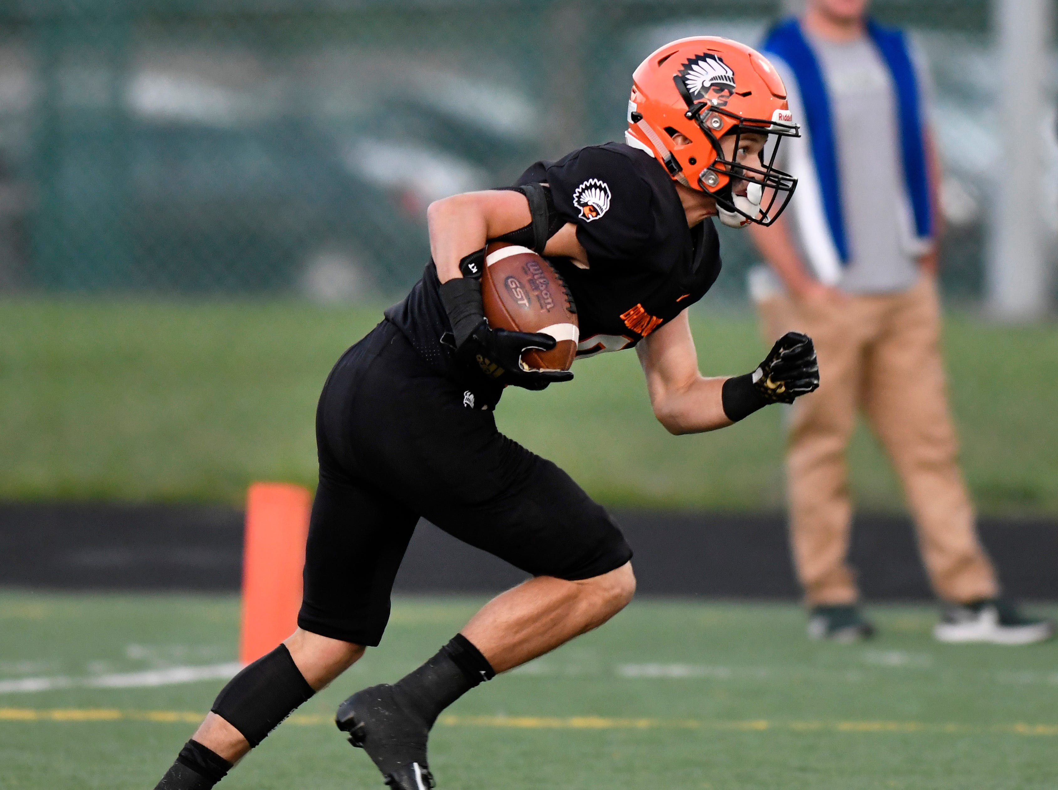 Birmingham Brother Rice kick returner Colin Gardner (9) returns a kickoff against Detroit Catholic Central in the first quarter, Saturday, Sept. 22, 2018 at Hurley Field in Berkley, Mich.  Catholic Central defeated Brother Rice, 21-0.  (Jose Juarez/Hometown Life)