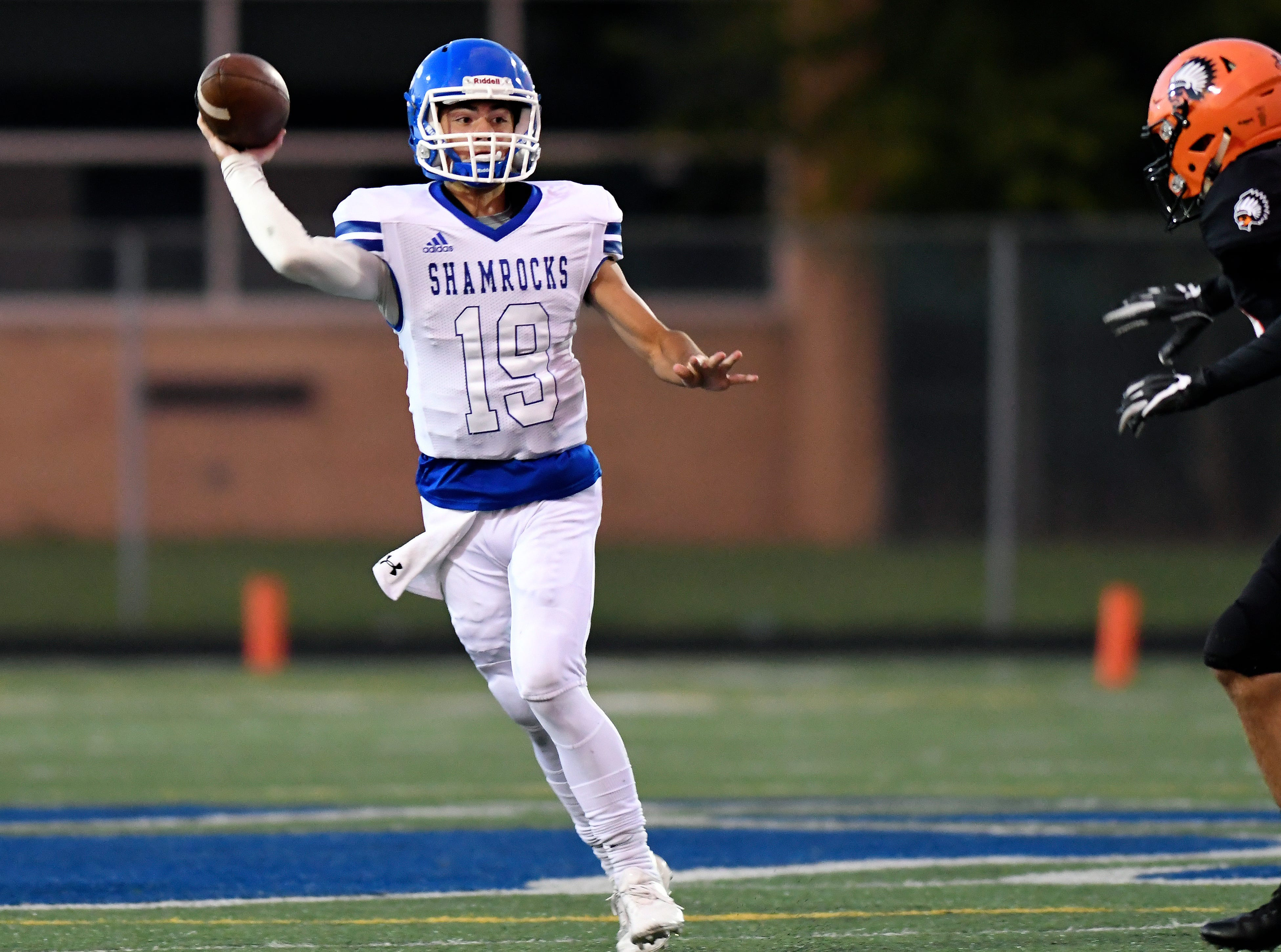 Detroit Catholic Central quarterback Jack Beno (19) passes against Birmingham Brother Rice in the second quarter, Saturday, Sept. 22, 2018 at Hurley Field in Berkley, Mich.  Catholic Central defeated Brother Rice, 21-0.