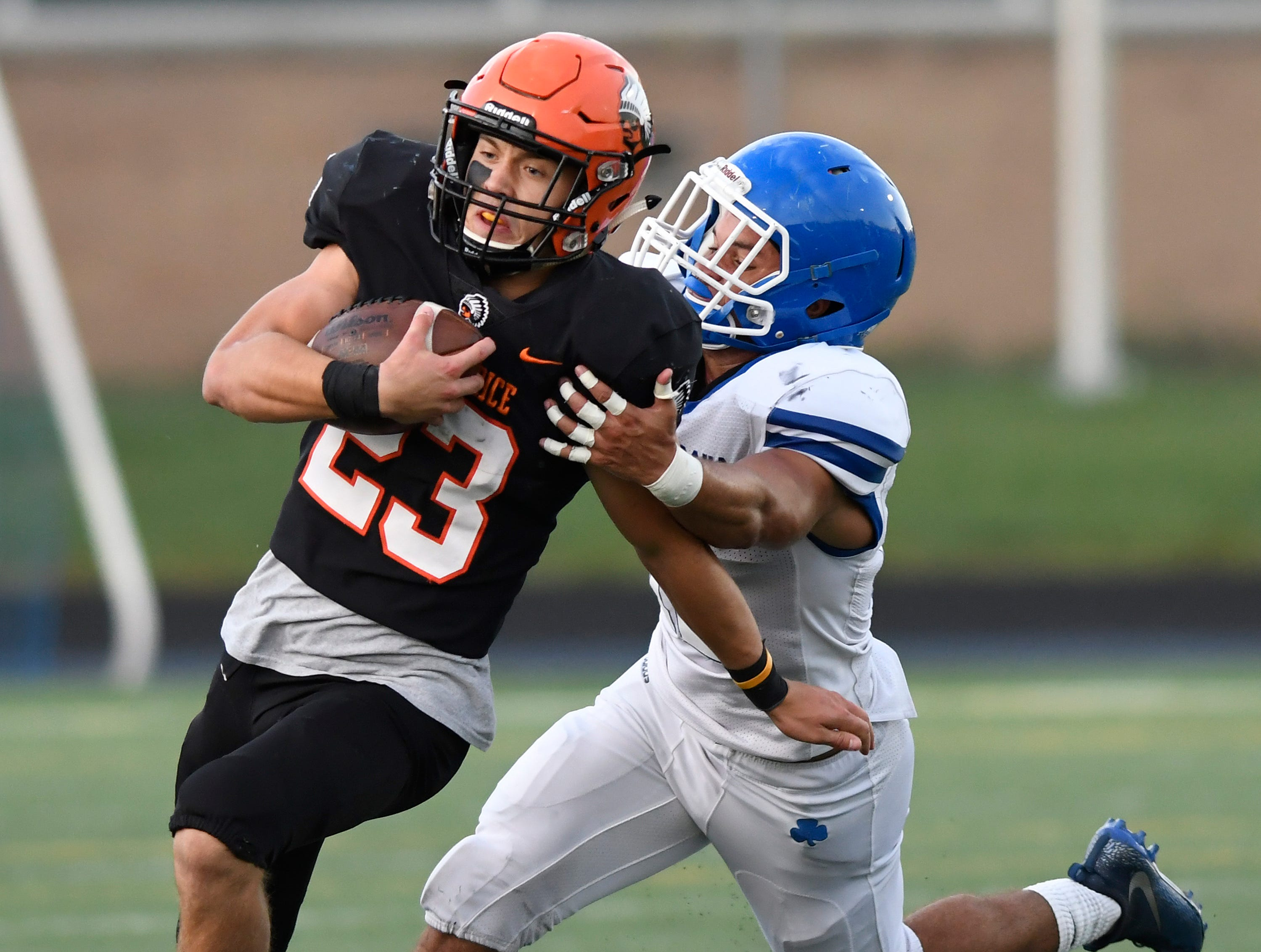 Birmingham Brother Rice running back James Donaldson (23) evades a tackle from Detroit Catholic Central linebacker Bryson Trantham (12) in the first quarter, Saturday, Sept. 22, 2018 at Hurley Field in Berkley, Mich.  Catholic Central defeated Brother Rice, 21-0.  (Jose Juarez/Hometown Life)
