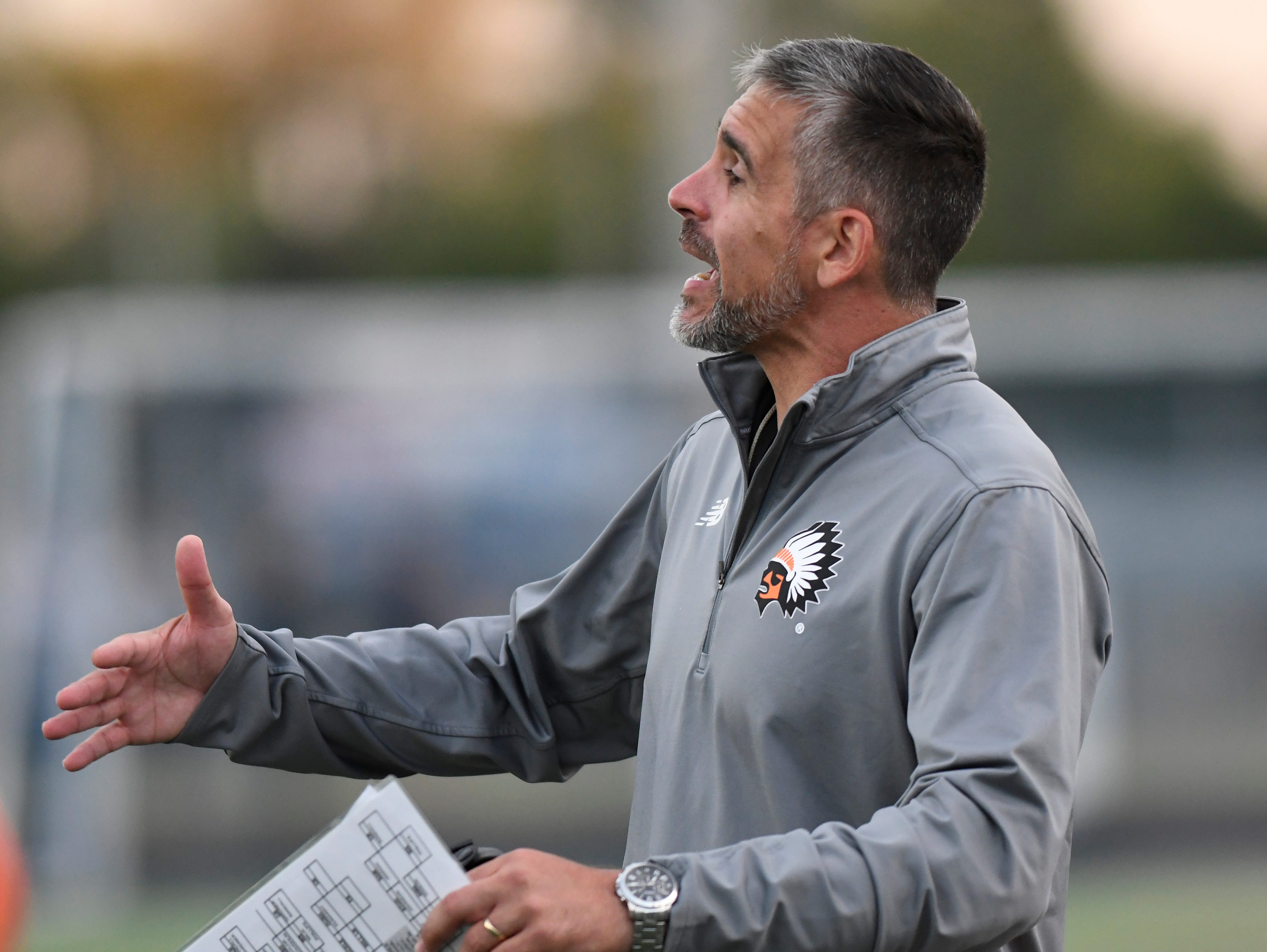 Birmingham Brother Rice head coach Adam Korzeniewski yells instructions to his team as they played against Detroit Catholic Central in the first quarter, Saturday, Sept. 22, 2018 at Hurley Field in Berkley, Mich.  Catholic Central defeated Brother Rice, 21-0.  (Jose Juarez/Hometown Life)