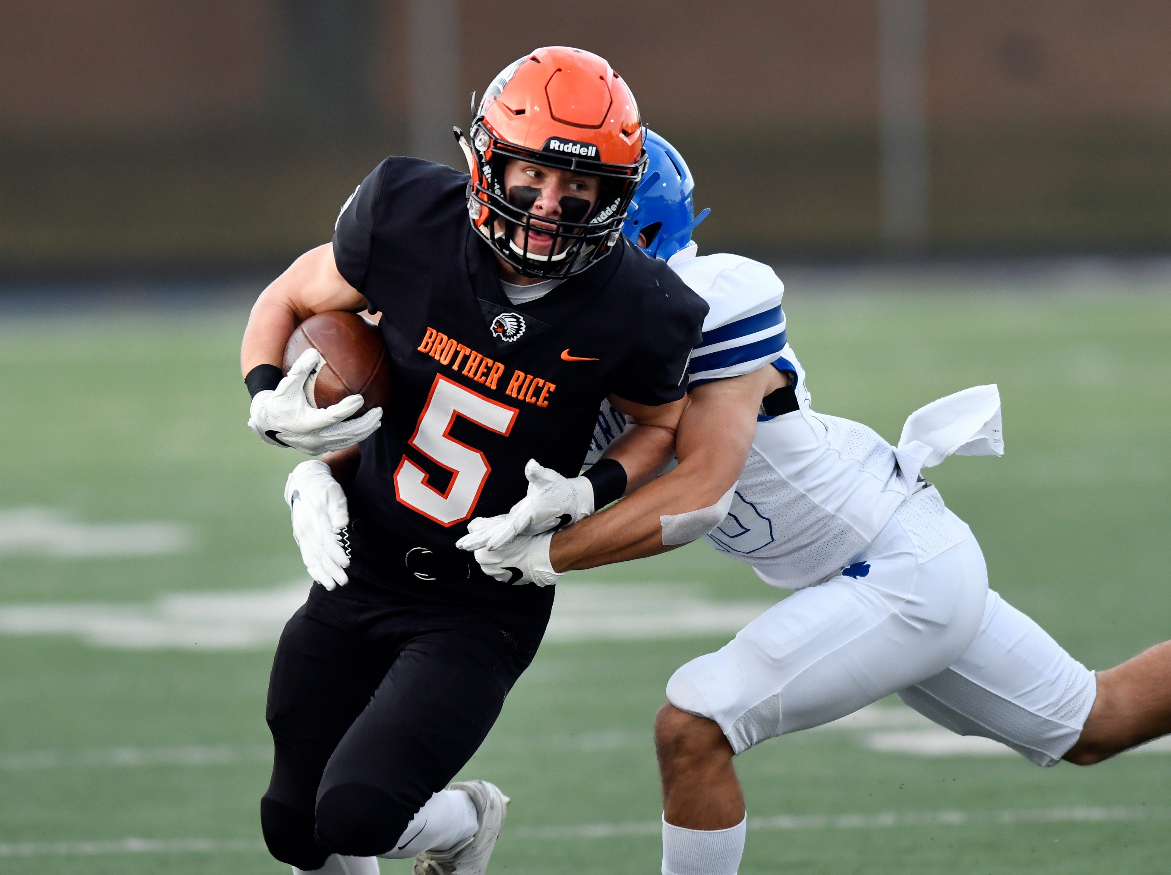 Birmingham Brother Rice wide receiver Patrick O'Hara (5) runs for yardage and is tackled by Detroit Catholic Central defensive back Parker Bohland (23) in the first quarter, Saturday, Sept. 22, 2018 at Hurley Field in Berkley, Mich.  Catholic Central defeated Brother Rice, 21-0.  (Jose Juarez/Hometown Life)
