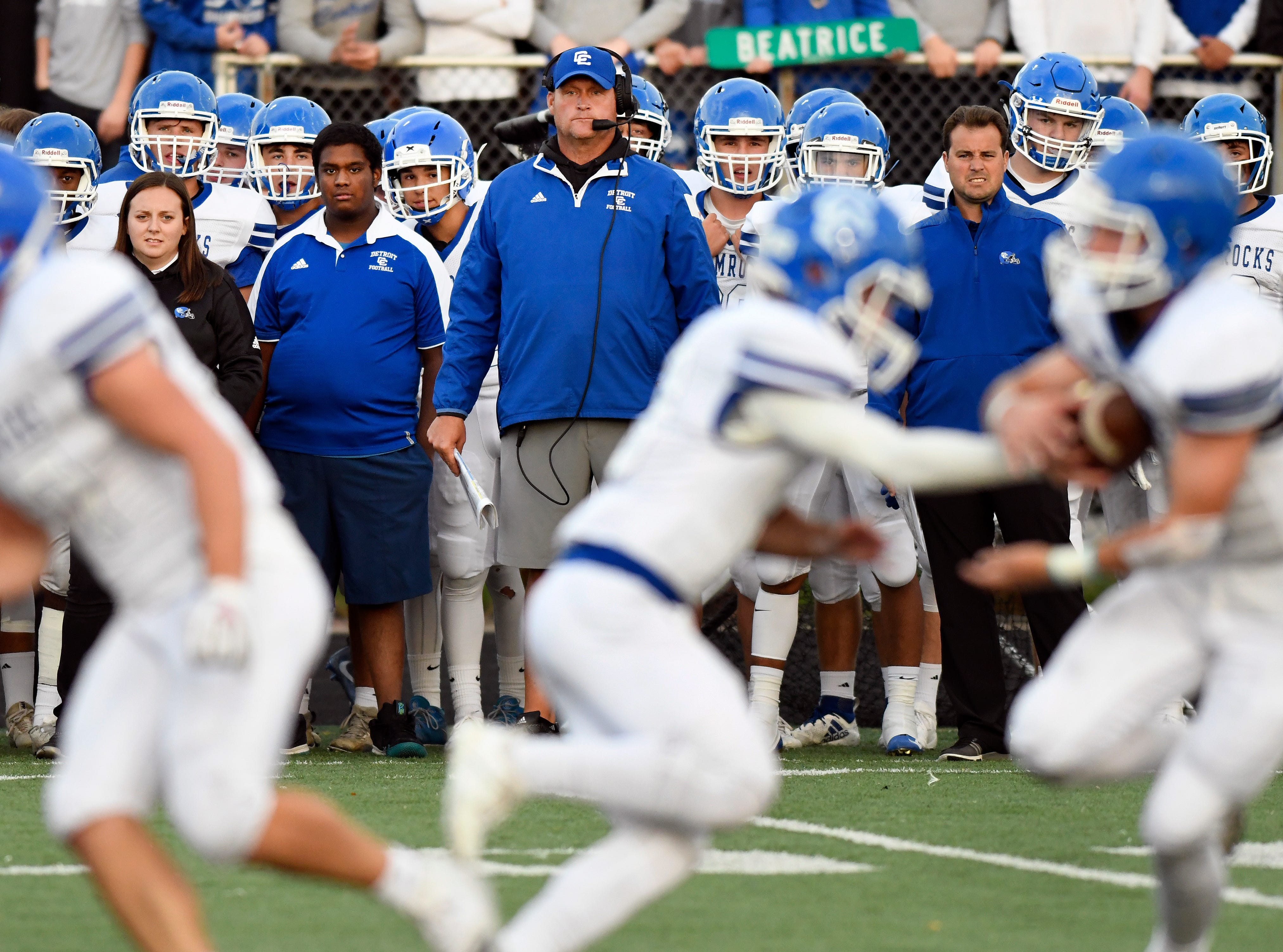 Detroit Catholic Central football head coach Dan Anderson, middle, watches his team play against Birmingham Brother Rice in the first quarter, Saturday, Sept. 22, 2018 at Hurley Field in Berkley, Mich.  Catholic Central defeated Brother Rice, 21-0.  (Jose Juarez/Hometown Life)