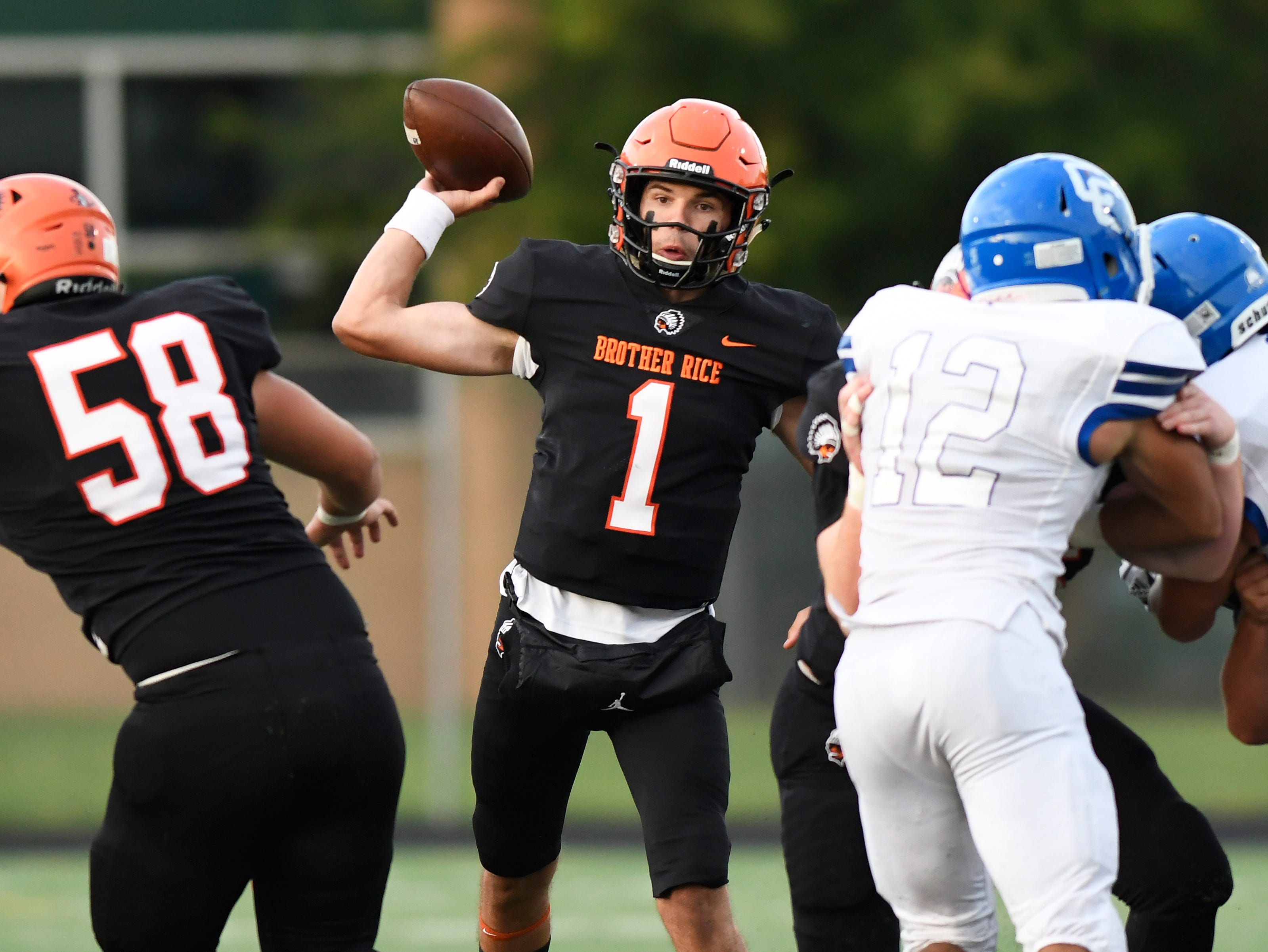 Birmingham Brother Rice QB/CB Greg Piscopink (1) passes against Detroit Catholic Central in the first quarter, Saturday, Sept. 22, 2018 at Hurley Field in Berkley, Mich.  Catholic Central defeated Brother Rice, 21-0.  (Jose Juarez/Hometown Life)