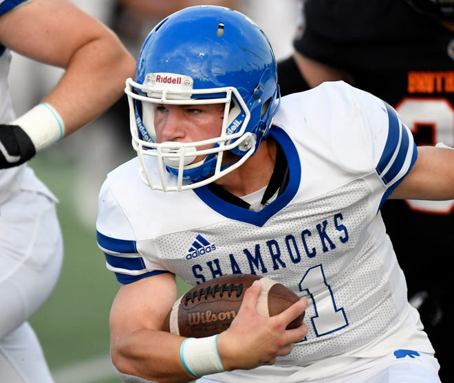 Detroit Catholic Central running back Keegan Koehler (21) rushes for yardage against Birmingham Brother Rice in the first quarter, Saturday, Sept. 22, 2018 at Hurley Field in Berkley, Mich.  Catholic Central defeated Brother Rice, 21-0.