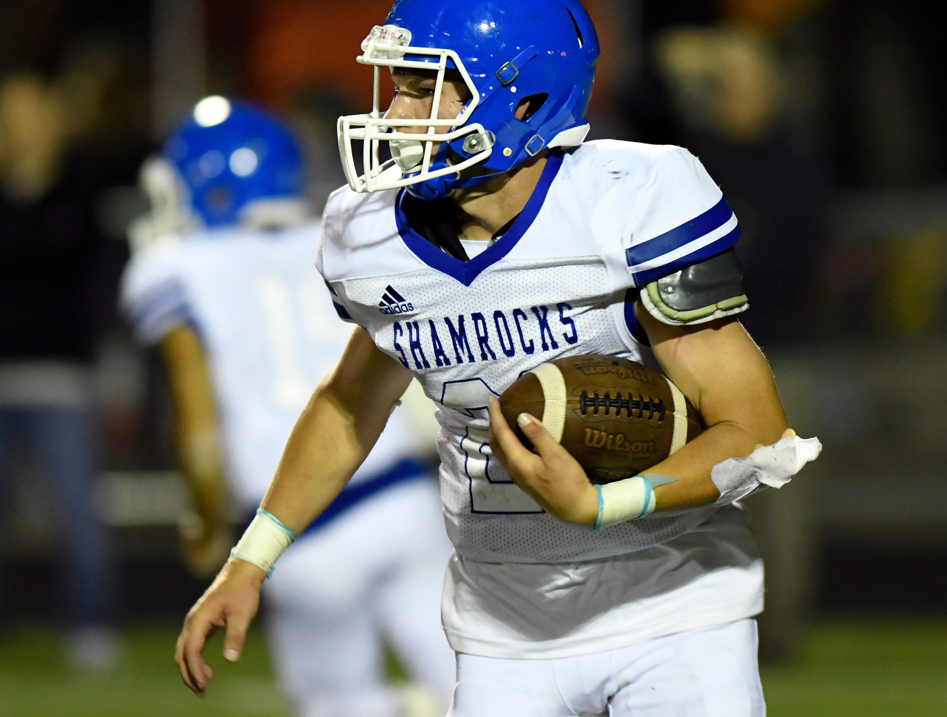 Detroit Catholic Central running back Keegan Koehler (21) runs for yardage against Birmingham Brother Rice in the third quarter, Saturday, Sept. 22, 2018 at Hurley Field in Berkley, Mich.  Catholic Central defeated Brother Rice, 21-0.